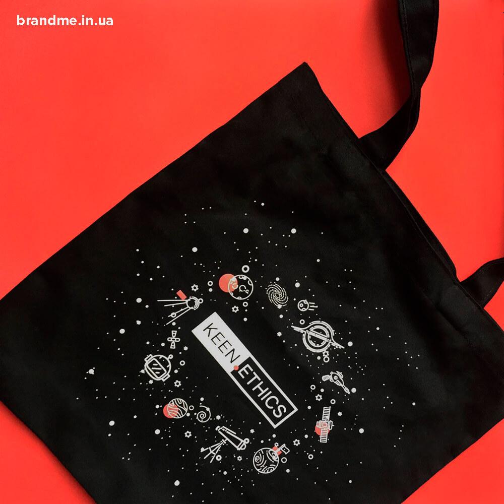 Чорні еко-сумки з логотипом з бавовни та спанбонду.