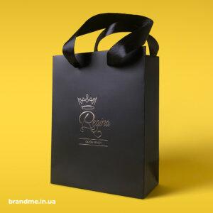 Пакети з атласними ручками та тисненням золотою фольгою для салону краси Regina