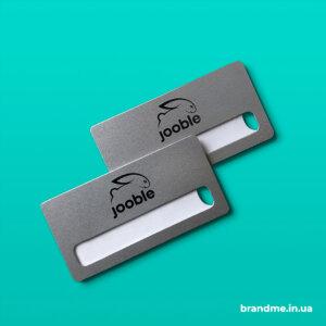 Металеві бейджі з віконечком для компанії Jooble